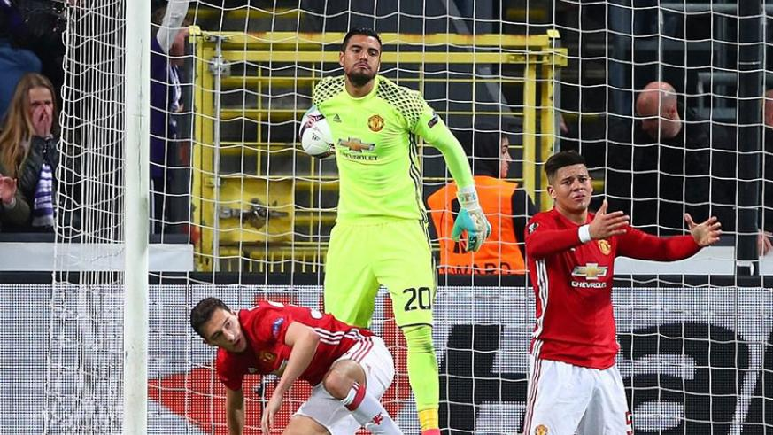 Marcos Rojo, Matteo Darmian and Sergio Romero look dejected in the aftermath of that late equaliser from Dendoncker. / Internet photo