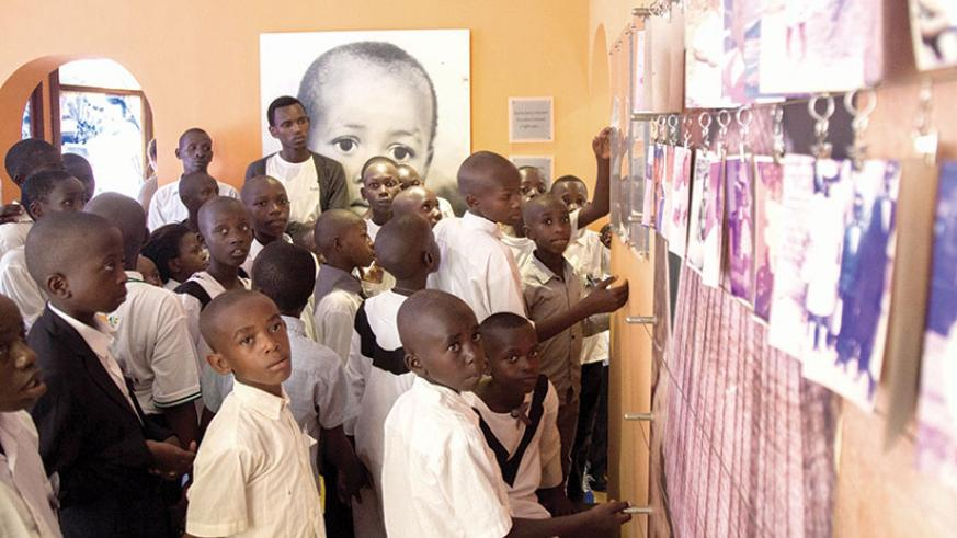 Children from Ndayisenga Fabrice Foundation (NFF) at the Gisozi memorial site in Kigali. The Ministry of Education children in primary schools taught the dangers of genocide ideolo....