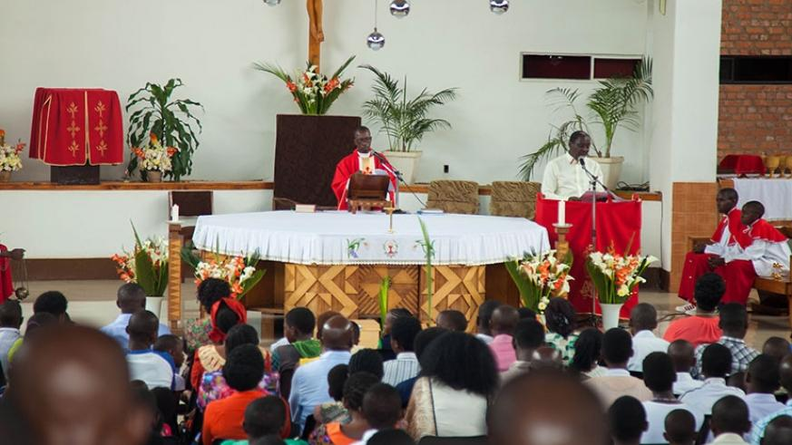 A priest preaching at Saint Michel church on Palm Sunday. Clergy from different churches have called for forgiveness as christains from all over the country celebrate the resurrect....