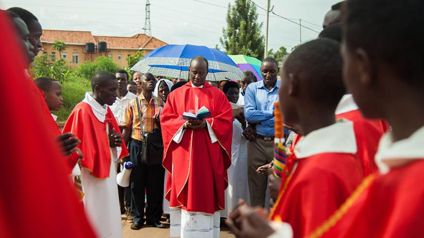 Fr. Eric Nzabamwita, the vicar of Kicukiro Parish in Kigali, delivers a sermon during a Way of the Cross procession on Good Friday. Story on page 3. Nadege Imbabazi.