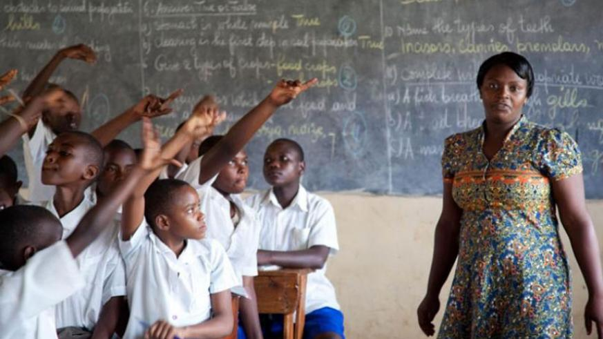 A teacher at Kimisagara Primary School in Kigali conducts a lesson. (Francis Byaruhanga)