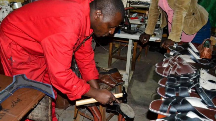 A man makes leather products in his workshop in Kigali. (File)