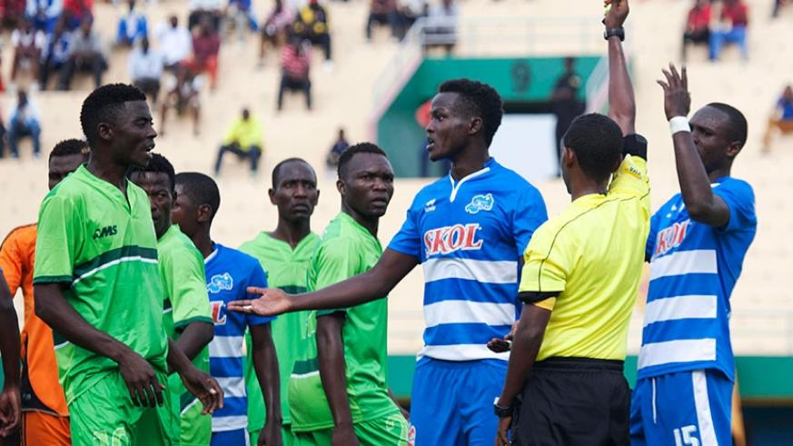 Ethiopian Haileyesus Bazezew Belete shows a red card to Rayon Sports' defender Ange Mutsinzi  against Al Wau Salam of S. Sudan in a previous round. S. Ngendahimana