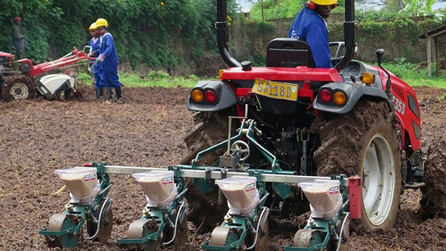 A trainee in agriculture mechanisation engages in sowing maize seeds using a maize planting machine at IPRC South in Huye District. Emmanuel Ntirenganya.