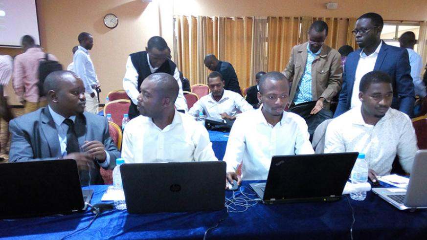 Mpabwanamaguru (left) with other architects at the end of the workshop. / Appolonia Uwanziga