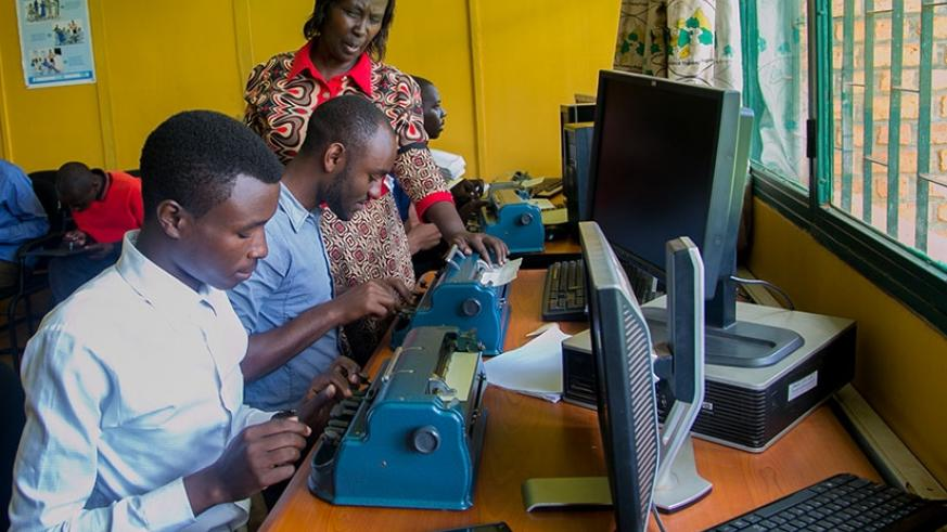 Dr Mukarwego checks the work of her students using a the Perkins Brailler machine. All photos by Faustin Niyigena)