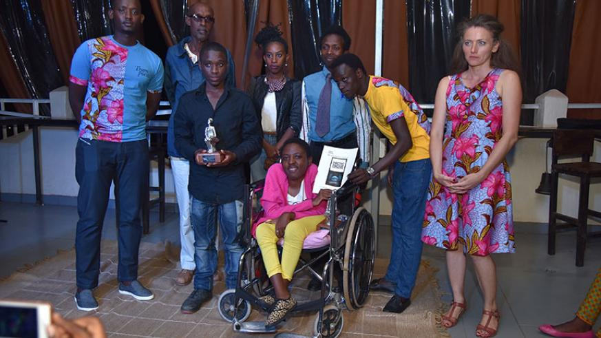 Ange Theonastine receives the first of 3 awards at the Kigali vibrates with poetry. Luqman Mahoro.