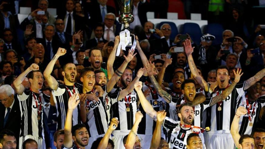 ROME - Juventus beat Lazio to win a third successive Italian Cup final as goals from Dani Alves and Leonardo Bonucci kept them on course for a treble this season with a 2-0 victory in the Olympic Stadium on Wednesday.