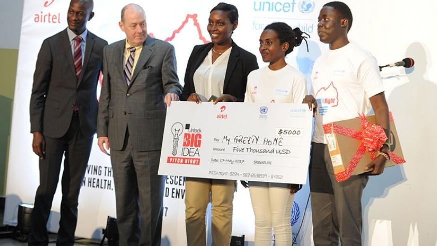 From L-R; Adjei, Maly and Irere award Umuhoza and Kinzuzi. (Courtesy)