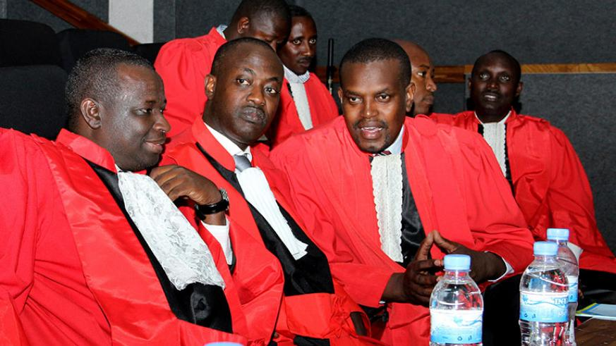 Prosecutor General Jean Bosco Mutangana (R) chats with his colleagues during the the opening of the Judicial Year at parliament last year. / File