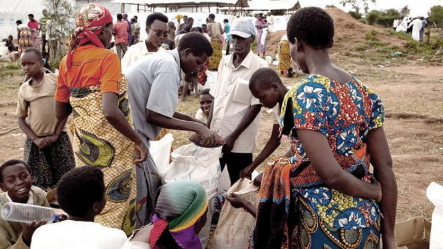 Burundian refugees receive ration at Mahama refugee centre in Kirehe District. / File