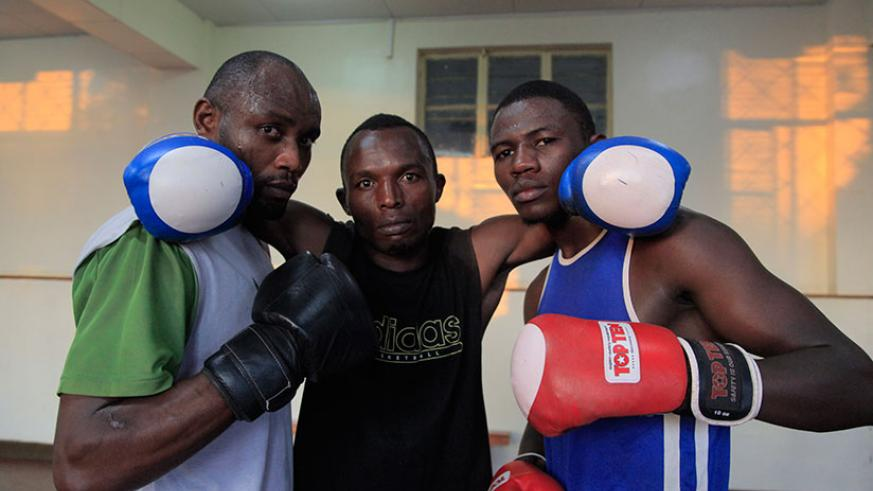 Boxers Vincent Nsengiyumva (L) David Nsabimana (C) and Jean-Pierre Cyiza pose for a photo after training as they prepared for the African Championships. / Sam Ngendahimana