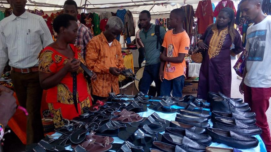 Showgoers admire shoes at a recent expo in Kigali. Rwanda is promoting consumption of local products to support industries and help reduce its growing import bill. / Apollonia Uwanziga.