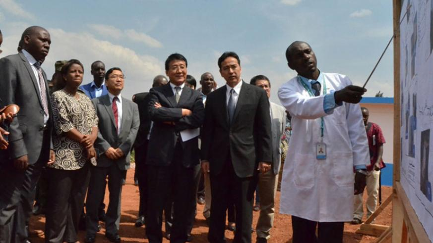 From left, Gatsibo Vice Mayor Economics Theogene Manzi, State Minister Mininfra Germaine Kamayirese, Japan's ambassador Takayuki Miyashita and two Japanese MPs looking at the summa....