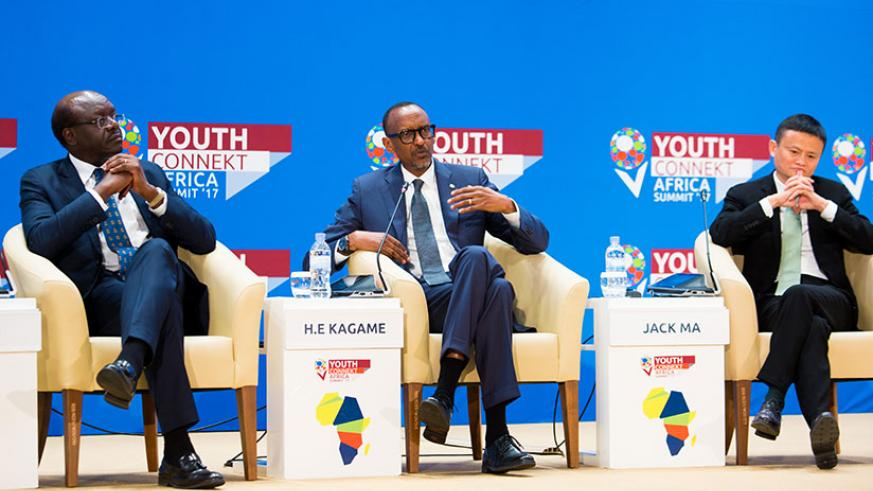 President Kagame speaks on a panel discussion with Jack Ma (R), the founder and chief executive of Alibaba Group, Asia's largest e-Commerce platform, and Dr Mukhisa Kituyi, the sec....
