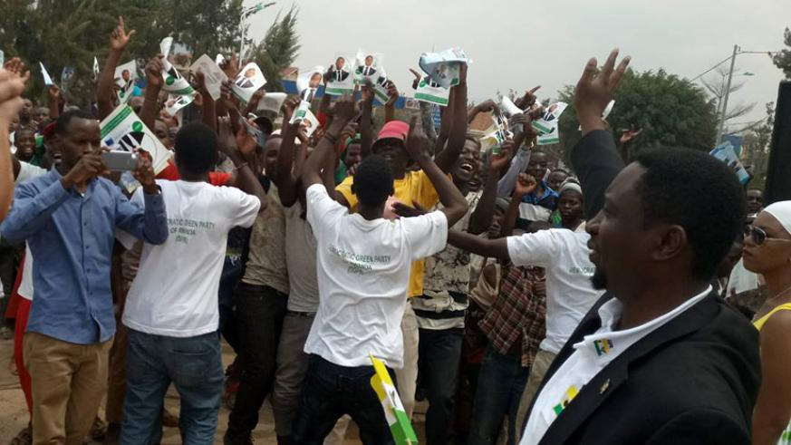 Frank Habineza greets supporters in Nyamagabe District. (Jean d'Amour Mbonyinshuti)