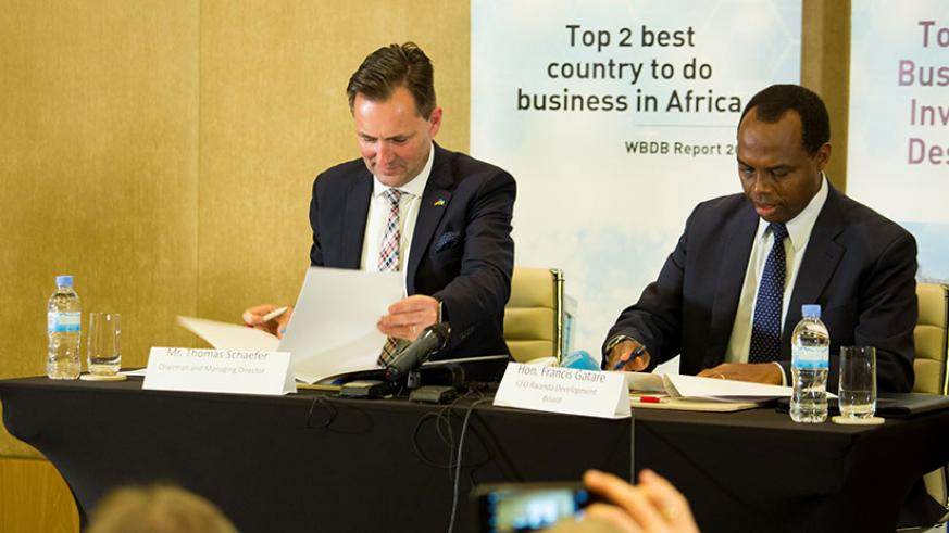 Thomas Schafer, the Chief Executive Officer of Volkswagen South Africa, signs a memorandum of understanding with former RDB Chief Executive Officer, Francis Gatare, last year for t....
