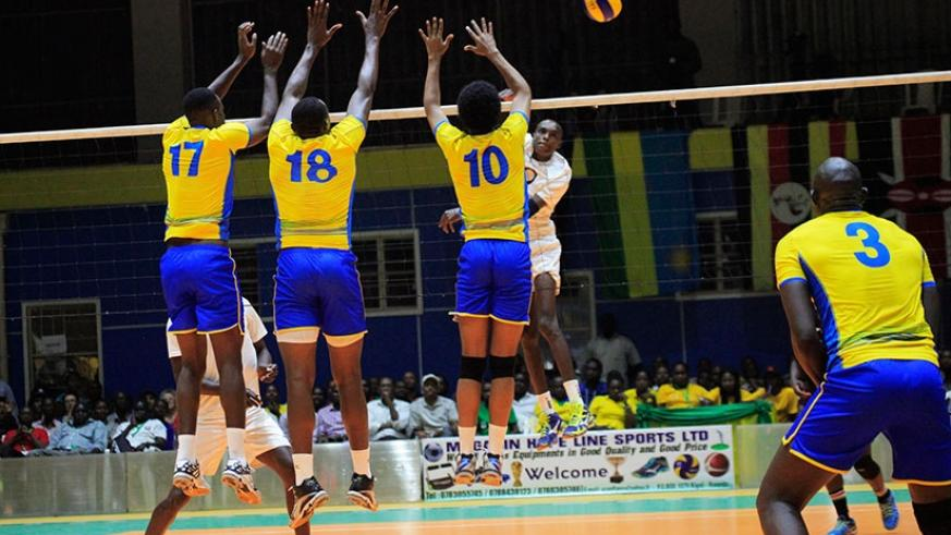 The national volleyball team players try to block a spike from a Kenyan player during the final game of the just - concluded Zone V at Amahoro indoor stadium. Sam Ngendahimana