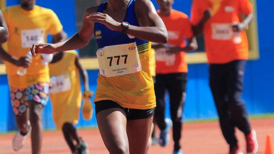 Salome Nyirarukundo reaches the finish during Kigali International Peace Half Marathon . She will represent Rwanda at 2017 IAAF World Championships in London. Sam Ngendahimana