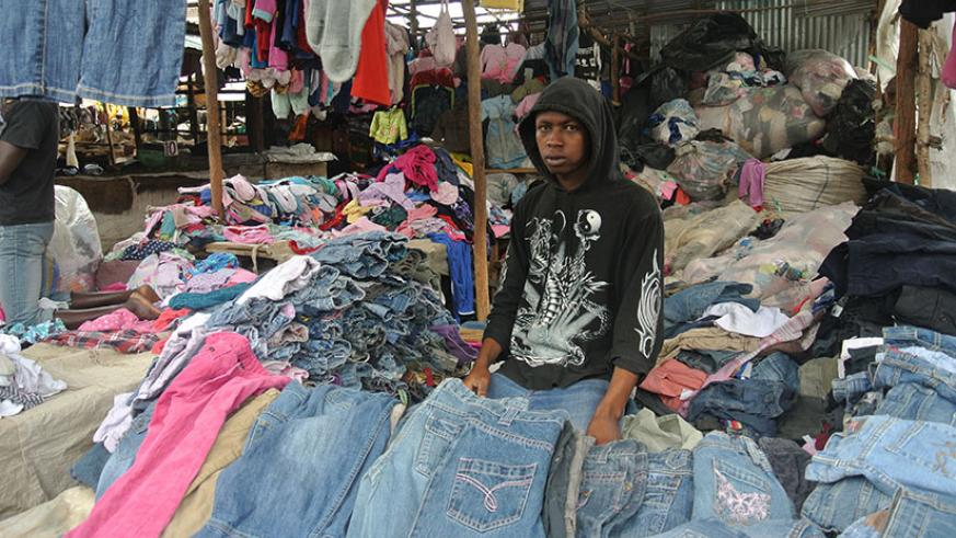 A second-hand clothes vendor at his stall. The ban of used clothes in the East African Community is aimed at promoting the region's textile and leather industries. / File