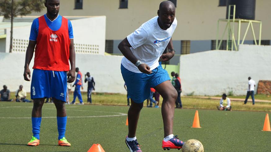 Former APR and Amavubi captain Olivier Karekezi shows Rayon Sports' players how it's done during his first training session on Friday at Mumena Stadium. / Sam Ngendahimana