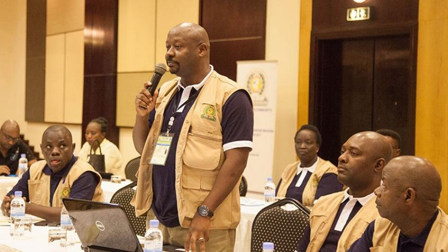 One of the observers gives a comment during the official launch of the EAC Observer Mission recently. Nadege K. Imbabazi