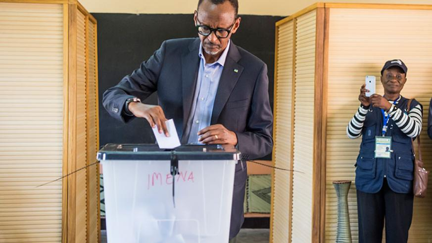 Kagame casts his vote at APE Rugunga School polling station in Nyarugenge District on Friday. The incumbent President garnered 98.66 per cent from 80 per cent of the votes counted ....