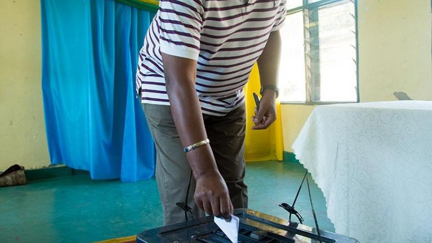 A voter casts his vote in Nyarutarama on Friday. Timothy Kisambira.