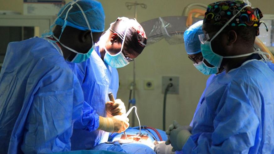 Prof. Butera (C) leads other doctors as they operate on a patient at King Faisal Hospital Kigali. Sam Ngendahimana.