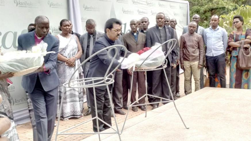 Bishop Joab lays a wreath on the mass graves at Kigali Genocide Memorial in Kigali on Tuesday. Jean d'Amour Mbonyinshuti.