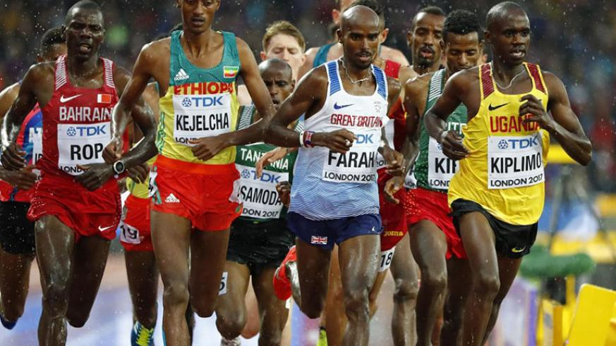 World and Olympic champion Mo Farah booked his place in the 5,000m final by finishing second in a rain-lashed heat at the London Stadium. / Internet photo