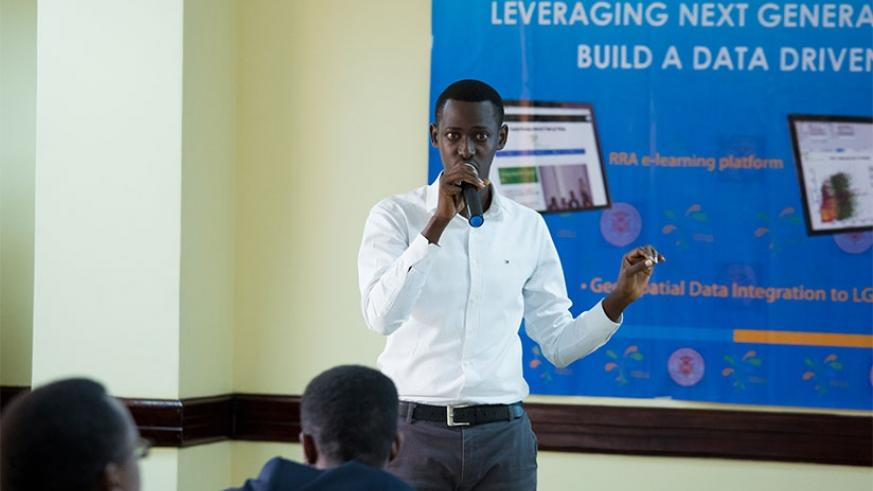 Darius Mico, one of the software developers, gives a presentation during the unveiling of the five applications in Kigali on Friday. Timothy Kisambira.