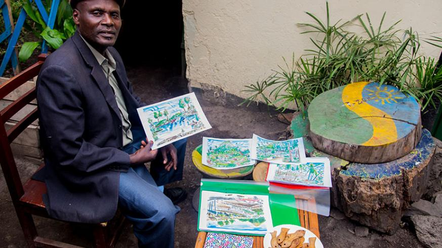 Charles Kamana Kalisa with his artworks. He is based in Gisenyi town in the Western Province. / Faustin Niyigena
