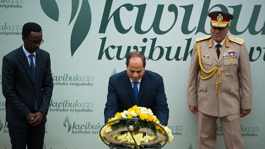 President El-Sisi lays a wreath on the mass grave at Gisozi memorial. TKisambira.