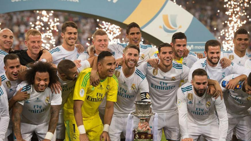 Real Madrid celebrate after beating Barcelona over two legs, home and away, to win the Spanish Super Cup on Wednesday. / Internet photo