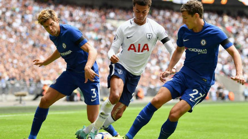 Tottenham star Dele Alli attempts to dribble between two challenges from Alonso and Andreas Christensen. / Internet photo