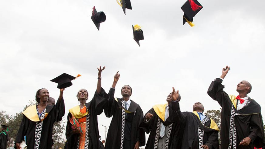 Happy graduates celebrate after getting their degrees. / File