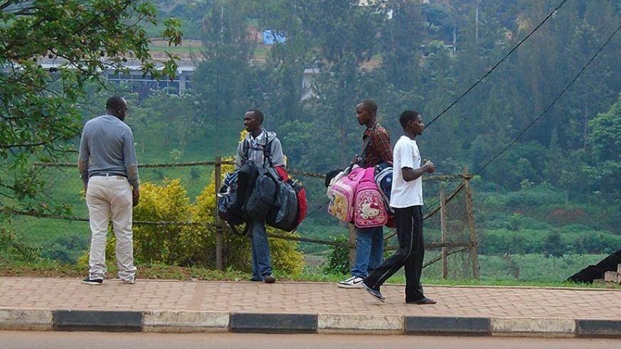 A man bargains with backpack vendors in Kigali. (Steven Muvunyi)