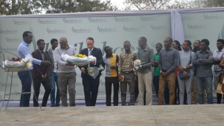 Ajeprodho staff and students lay a wreath at the Gisozi memorial site. / Francis Byaruhanga