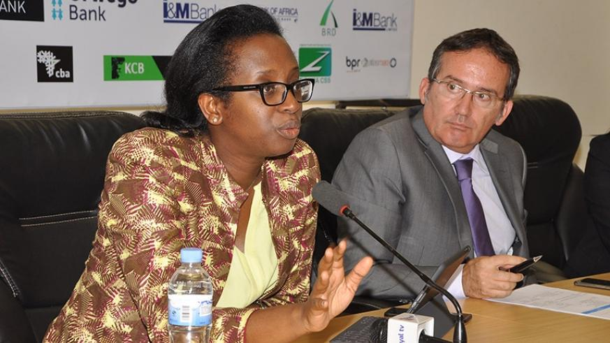 Rwanda Bankers Association Chairperson, Dr. Diane Karusisi, left, addressing the press on Tuesday afternoon. Damas Sikubwabo