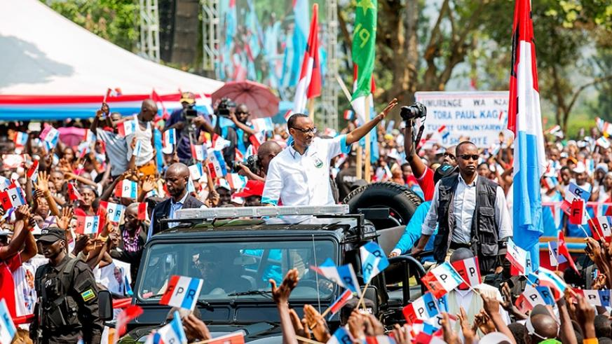 President Paul Kagame waves at thousands of supporters in Rusizi District where he held two rallies during the recent campaigns. File.