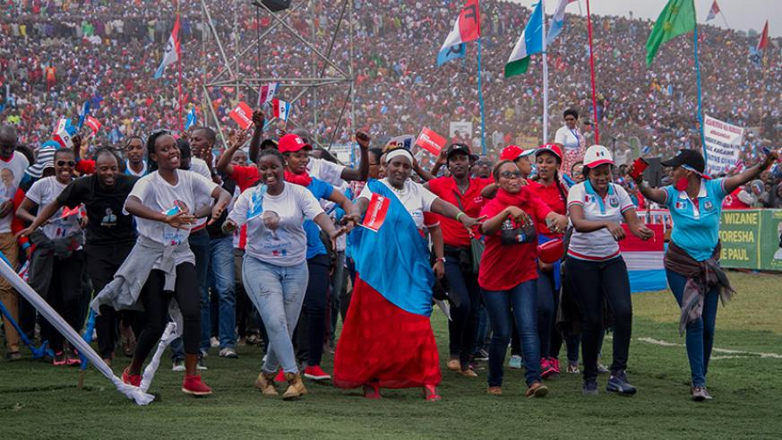 People chant and dance at RPF-Inkotanyi's presidential candidate Paul Kagame's campaign rally in Rubavu District last month. File.