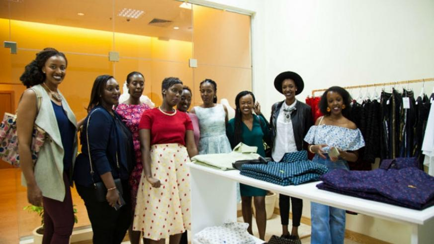Sonia Mugabo with friends and clients in her new store at Marriott.