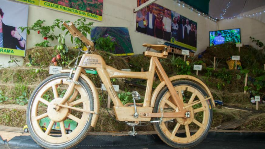 A wooden bicycle a new product by Sina Gerard was showcased and demonstrated to hundreds of people attending the 20th Kigali International Expo at Gikondo ground. / Frederick Byumvuhore