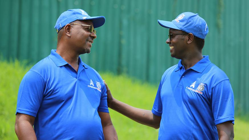 Njombo Lekula, the outgoing MD of International Operations at PPC the partnering company of CIMERWA shares a light moment with Emmanuel Hategeka, the Chief Operating Officer of Rwa....