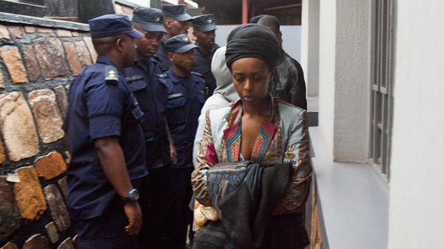 Diane Shima Rwigara getting out of the house after the Police presents her warrant. (Photos by Nadege Imbabazi)