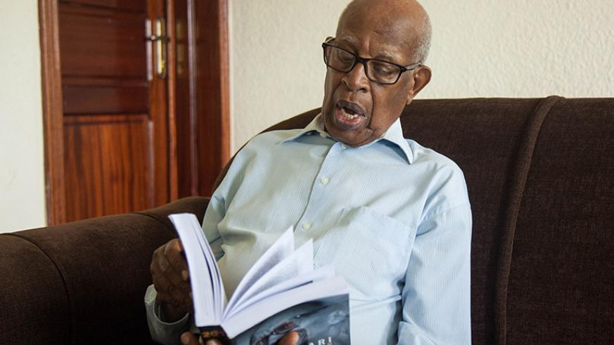 Despite his advanced age, Pastor Mpyisi is still a keen reader. He was reading 'Intwari y'Izahabu', a book about the life and heroics of President Kagame. / Nadege Imbabazi