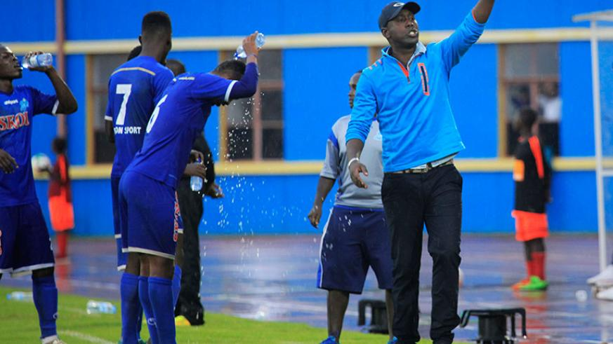 Rayon Sports head coach Olivier Karekezi belts out instructions to his players during the game. Rayon beat Police FC 1-0 at Amahoro National Stadium yesterday. / Sam Ngendahimana