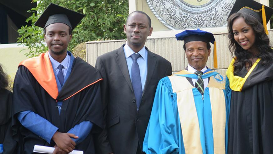 HEC's Muvunyi (second left), AUCA Chancellor Dr Ruguri pose for photo with best graduates (Photos by Eddie Nsabimana)
