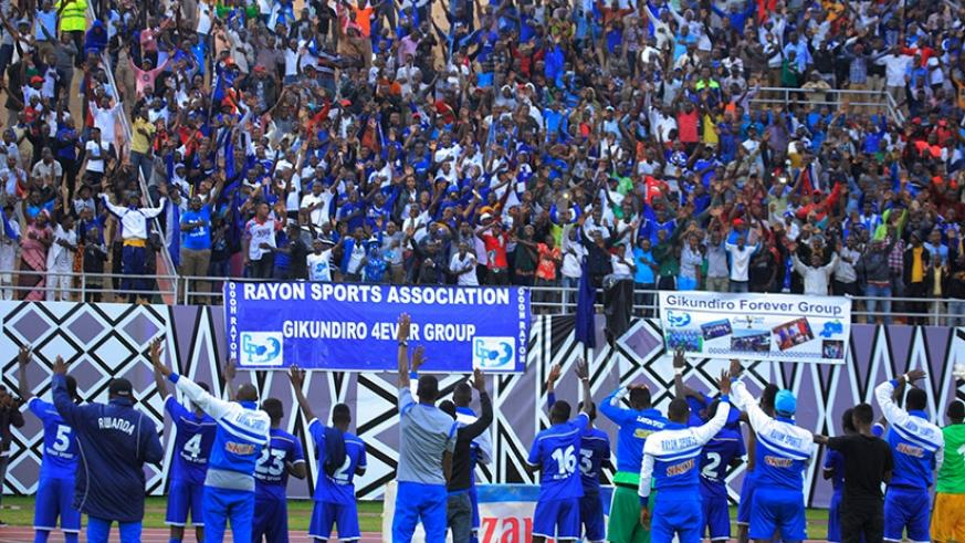 Rayon Sports  players acknowledge the support of their fans following the 1-0 victory over Police FC on Saturday at Amahoro National Stadium. S. Ngendahimana